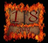 Burning wooden calendar July 18. — Stock Photo
