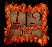 Burning wooden calendar July 19. — Stock Photo