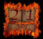 Burning wooden calendar July 21. — Stock Photo