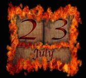 Burning wooden calendar July 23. — Stock Photo