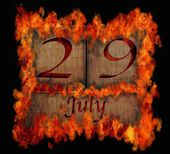 Burning wooden calendar July 29. — Stock Photo