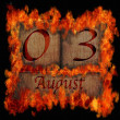 Stock Photo: Burning wooden calendar August 3.