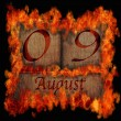 Stock Photo: Burning wooden calendar August 9.
