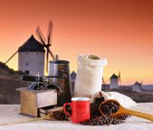 Coffee beans and old windmills. — Stock Photo