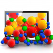 Colored spheres falling from 3D TV — Stock Photo