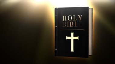 Holy bible with magic glow — Vídeo Stock