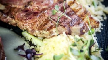 Lamb fillet and chop on asparagus cream with roasted couscous — Stock Video