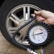 Checking Tire Pressure — 图库照片
