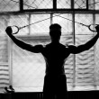 Stock Photo: Bodybuilder training gym