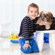 Happy boy with dog — Stock Photo