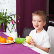 Happy boy having breakfast — Stock Photo