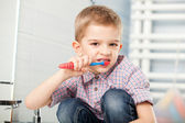 Five year old child brushing — Stock Photo