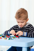Kid at home playing — Stock Photo