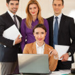 Stock Photo: Business womwith her team