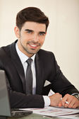 Handsome business man with laptop — Stock Photo
