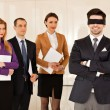 Stock Photo: Businessmeyes covered