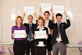 Team of business people holding cardboards — Stock Photo