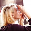 Stockfoto: Womapplying false lashes
