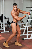 Young bodybuilder in the gym — Stock Photo