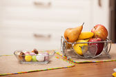 Sweets and fruits on the table — Stock Photo