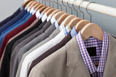 Man suits in a closet — Stock Photo