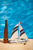 Telescope and ship next to the pool — Stock Photo