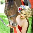 Woman with bright makeup on the horse outdoors — Stock Photo #15445921
