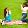 Stock Photo: Photo session two women outdoors