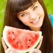 Woman with juicy watermelon in hands — Stok fotoğraf