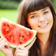 Woman with juicy watermelon in hands — Stock Photo