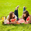 Two women on a picnic with watermelon — Stock Photo
