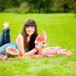 Woman with juicy watermelon in hands — 图库照片
