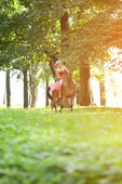 Woman with bright makeup on the horse outdoors — Stock Photo
