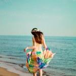 Luxurious beautiful fashionable woman on the beach — Stock Photo #15450861