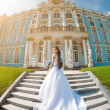 Luxury bride near palace — Foto Stock
