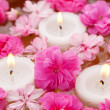 Candle with flowers — Stock Photo