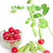 Peas and tomatoes — Stock Photo