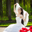 Bride with flowers — Stock Photo