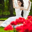 Bride with flowers — Stockfoto