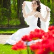 Bride with flowers — Stock Photo #27075625