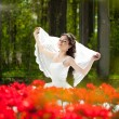 Bride with flowers — Stock Photo #27075645