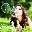 Woman and soap bubbles — Stock Photo