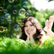 Woman and soap bubbles — Stockfoto