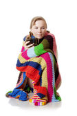 Woman in blanket with a large cup — Stock Photo