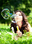 Woman and soap bubbles — Foto Stock