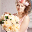 Vintage woman with flowers — Stock Photo
