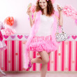 Sexy young woman in pink room — Stock Photo #27082385