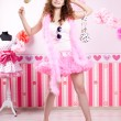 Sexy young woman in pink room — Stock Photo #27082405