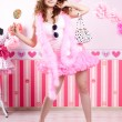 Sexy young woman in pink room — Stock Photo #27082411
