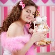 Sexy young woman in pink room — Stock Photo #27082465